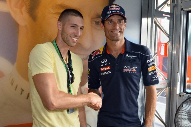 27 Jul 2013, Budapest, Hungary --- Mark Webber (AUS) Red Bull Racing and Krisztian Berki (HUN) Gymnast. Formula One World Championship, Rd10, Hungarian Grand Prix, Qualifying, Hungaroring, Hungary. Saturday 27 July 2013. --- Image by © Sutton Images/Corbis